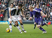 Photo: Steve Bond/Richard Lane Photography. West Bromwich Albion v Newcastle United. Barclays Premiership. 07/02/2009. Damien Duff (R) cuts inside Carl Hoefkens (L)