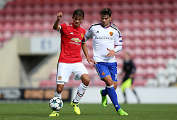 Manchester United's Thomas Sang and Basel's Sergei Eremenko battle for the ball