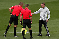 Brendan Rogers manager of Leicester City touches elbows with referee Craig Pawson and the officials during the Premier League match at Vicarage Road, Watford. Picture date: 20th June 2020. Picture credit should read: Darren Staples/Sportimage