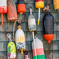 Colorful old lobster pot floats decorate this seafood business in Bernard, Maine.