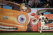 San Francisco Giants left fielder Jarrett Parker (6) chases down a ball in left field against the Los Angeles Dodgers at AT&T Park in San Francisco, California, on September 13, 2017. (Stan Olszewski/Special to S.F. Examiner)
