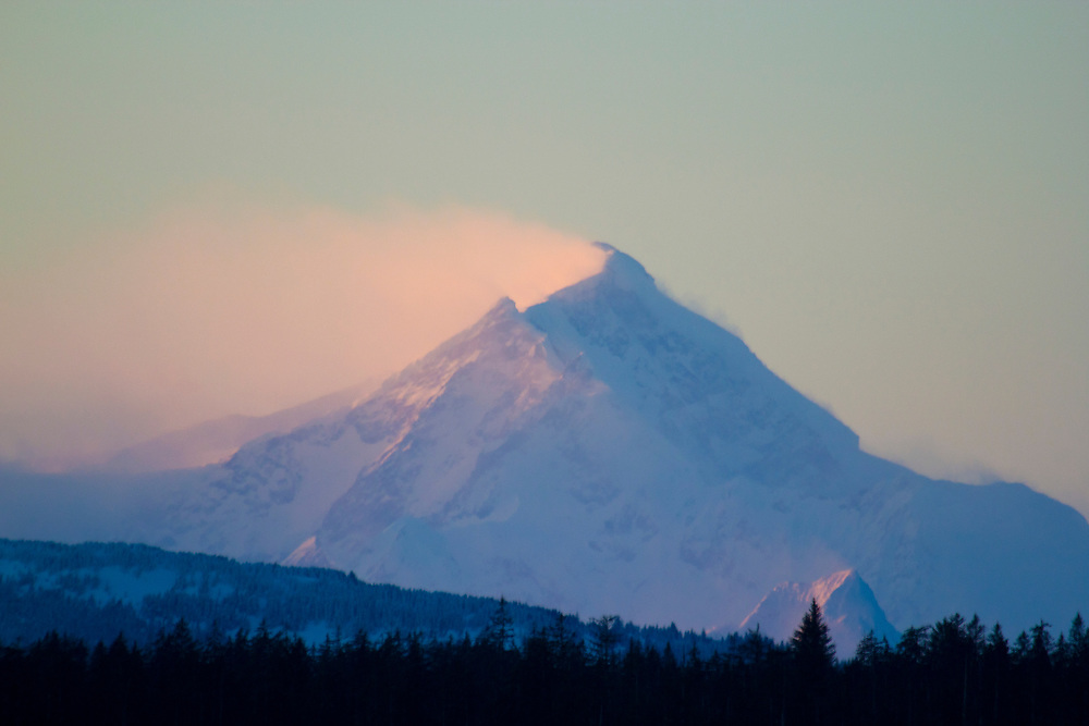 Mt. Crillon, 12,224' gets buffeted by high winds in pink morning light.