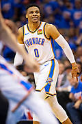 OKLAHOMA CITY, OK - APRIL 21: Russell Westbrook #0 of the Oklahoma City Thunder watches his shot during a game against the Portland Trail Blazers during Round One Game Three of the 2019 NBA Playoffs on April 21, 2019 at Chesapeake Energy Arena in Oklahoma City, Oklahoma  NOTE TO USER: User expressly acknowledges and agrees that, by downloading and or using this photograph, User is consenting to the terms and conditions of the Getty Images License Agreement.  The Trail Blazers defeated the Thunder 111-98.  (Photo by Wesley Hitt/Getty Images) *** Local Caption *** Russell Westbrook