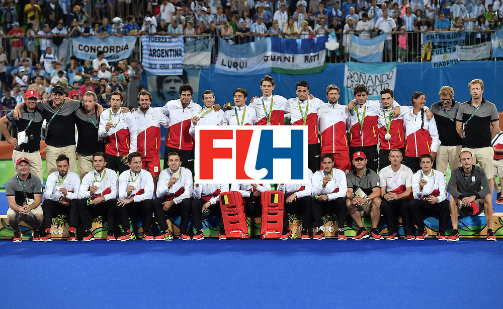 Belgium's players pose on the podium with their silver medals during the men's field hockey medals ceremony of the Rio 2016 Olympics Games at the Olympic Hockey Centre in Rio de Janeiro on August 18, 2016. / AFP / Pascal GUYOT        (Photo credit should read PASCAL GUYOT/AFP/Getty Images)