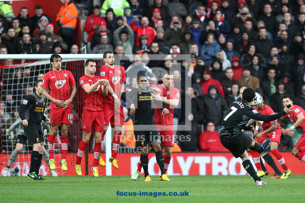Picture by Daniel Chesterton/Focus Images Ltd +44 7966 018899.16/03/2013.Luis Suarez of Liverpool takes a free kick during the Barclays Premier League match at the St Mary's Stadium, Southampton.