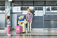Woman traveling with her daughter in airport