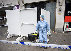 © Licensed to London News Pictures. 03/01/2019. London, UK. Police forensics return to 80 Park Lane in Mayfair where security guard Tudor Simionov was stabbed to death in the early hours of New Year's day. The 33-year-old and his colleagues were attacked by a group of men who were trying to gain entry to a party at Fountain House, a £12.5 million townhouse in London's West End.. Photo credit: Ben Cawthra/LNP