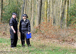 ©London News pictures. 22/03/11.  Two police officers observe the volunteers. Locals and friends of Sian O'Callaghan help Police in the search in Savernake Wood, Wiltshire, today. Detectives continue investigating the disappearance of office administrator Sian O'Callaghan. The 22-year-old disappeared after leaving Suju nightclub in Swindon at about 2.50am on Saturday to walk the half-mile home to the flat she shared with her boyfriend Kevin Reape. Picture Credit should read Stephen Simpson/LNP