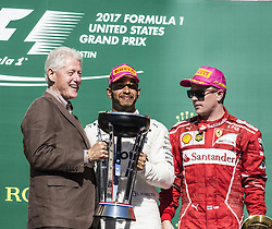 October 22, 2017 - Austin, Texas, U.S - Former 42nd President of the United States BILL CLINTON presenting the trophy to the winner #44 LEWIS HAMILTON driver for Mercedes AMG Petronas F1 Team. (Credit Image: © Hoss Mcbain via ZUMA Wire)