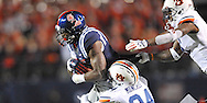 Ole Miss' wide receiver Laquon Treadwell (1) is tackled by Auburn Tigers' defensive back Derrick Moncrief (24) and Auburn Tigers' defensive back Jonathon Mincy (6) at Vaught-Hemingway Stadium in Oxford, Miss. on Saturday, November 1, 2014. Auburn won 35-31.(AP Photo/Oxford Eagle, Bruce Newman)