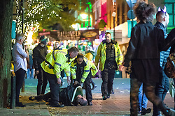 © Licensed to London News Pictures . 27/10/2018. Manchester, UK. Police place a man in handcuffs on Canal Street in Manchester City Centre . Revellers on a night out , many in fancy dress , on the weekend before Halloween . Photo credit: Joel Goodman/LNP