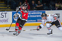 KELOWNA, CANADA - OCTOBER 5:  Riley Stadel #3 of the Kelowna Rockets is stick checked by Adam Rossignol #17 of the Portland Winterhawks  at the Kelowna Rockets on October 5, 2013 at Prospera Place in Kelowna, British Columbia, Canada (Photo by Marissa Baecker/Shoot the Breeze) *** Local Caption ***
