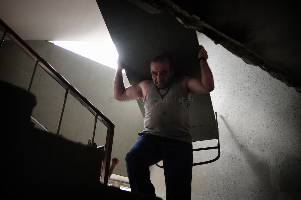 A Georgian man who fled his village after a Russian attack carries a bed in the former Russian Ministry of Justice on August 29, 2008 in Tbilisi. Russia is facing an avalanche of criticism from the West over its decision to recognise the independence of two Georgian secessionist regions at the heart of the conflict: South Ossetia and Abkhazia.