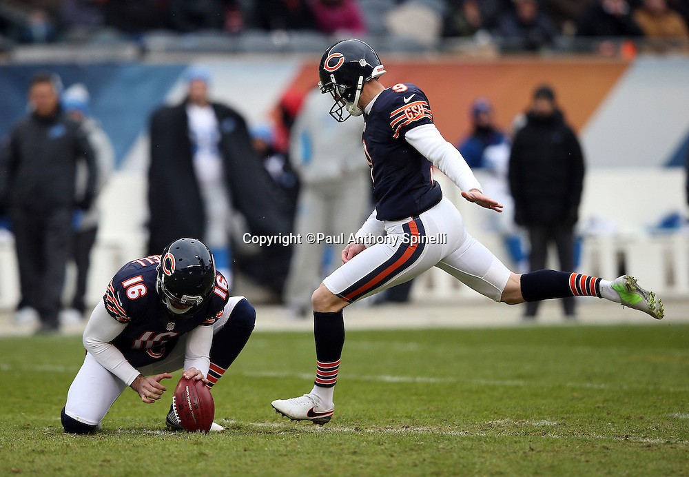 Chicago Bears punter Pat O'Donnell (16) holds while Chicago Bears kicker Robbie Gould (9) kicks a 49 yard field goal that cuts the Detroit Lions third quarter lead to 10-3 during the NFL week 17 regular season football game against the Detroit Lions on Sunday, Jan. 3, 2016 in Chicago. The Lions won the game 24-20. (©Paul Anthony Spinelli)