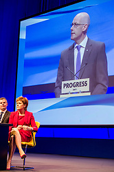 Pictured: Derek Mackie, MSP , Cabinet Secretary for Finance and the Constitution, Nicola Sturgeon, First Minister; John Swinney, Deputy First Minister<br /> The members of the SNP gathered in the Scottish Events Centre in Glasgow for their annual conference.<br /> <br /> Ger Harley | EEm 8 October 2017