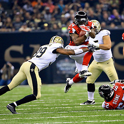 Oct 15, 2015; New Orleans, LA, USA; Atlanta Falcons running back Devonta Freeman (24) is tackled by New Orleans Saints cornerback Brandon Browner (39) during the first quarter of a game at the Mercedes-Benz Superdome. Mandatory Credit: Derick E. Hingle-USA TODAY Sports