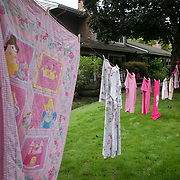 Pink Laundry hangs on a clothesline by a resident along the Red Course during the annual Pink Ball Tournament in Charbonneau.<br /> Photo by Jaime Valdez