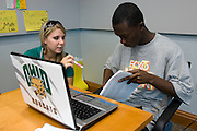 College of Business Pre-College, Summer 2008: Class Registration..Student Advisor Lauren Desjardins talks with incoming freshman Osei Sencherey during Ohio University Summer Pre-College Class Registration..Photos By: Joshua Armstrong