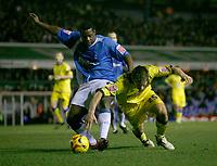 Leeds attacker Richard Cresswell (right) goes down under pressure from Birmingham defender Bruno N'Gotty
