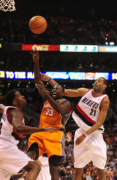 Mar. 21 2010; Phoenix, AZ, USA; Phoenix Suns guard Jason Richardson (23) puts up a shot against Portland Trailblazers forward Martell Webster (23) and forward Marcus Camby (21) in the second half at the US Airways Center. The Suns defeated the Trail Blazers 93 to 87. Mandatory Credit: Jennifer Stewart-US PRESSWIRE.