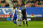Referee Gavin Ward shows a yellow card to Derby County midfielder Craig Bryson (4) during the EFL Sky Bet Championship match between Wigan Athletic and Derby County at the DW Stadium, Wigan, England on 8 December 2018.