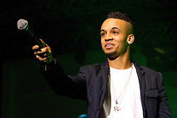 © Licensed to London News Pictures. 10/12/2012. Birmingham, UK. Aston Merrygold of JLS performs on the Susuki Fashion Theatre catwalk at Clothes Show Live. Photo credit : Ashley Hugo/LNP