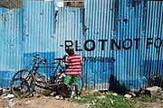 Nairobi, Kenya -   2015-04-02  -  Charles Kinyua, 7, explores a bicycle near his home in the Makuru slum of Nairobi, Kenya on April 2, 2015. Charles has been taught basic communication skills by CBR program workers. Photo by Daniel Hayduk