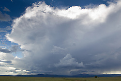 dramatic cloud formation over a flat field in New Mexico