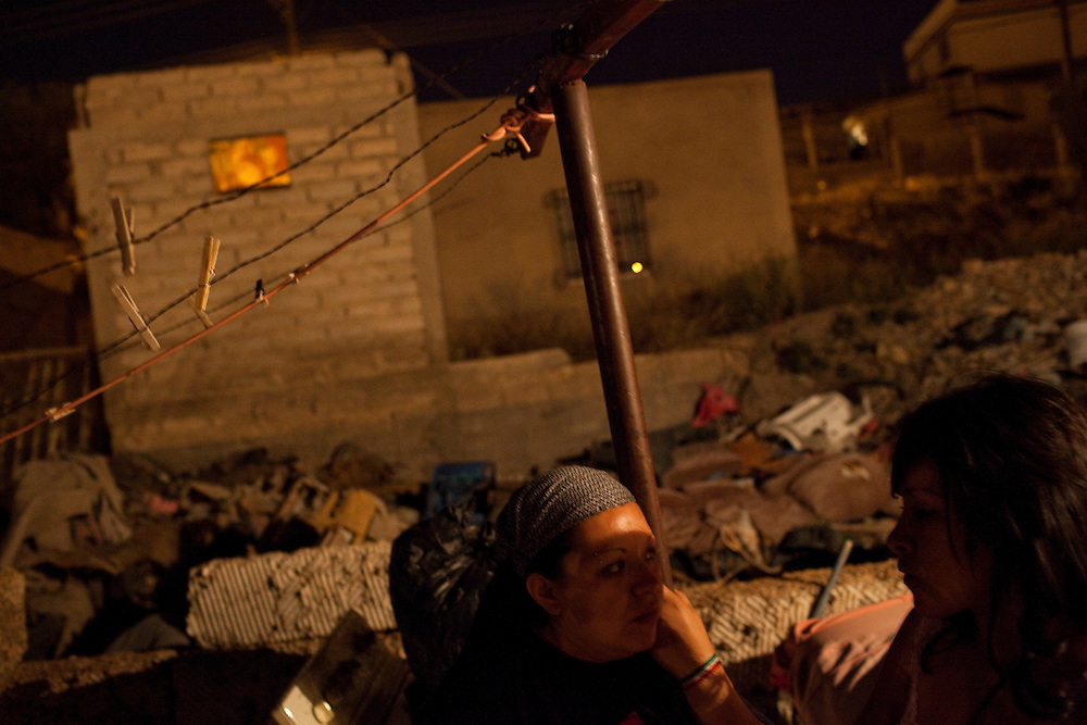 From left, Lidia de la Torre Vazquez, 32, a mother and a centrical force among youth in her neighborhood listens to Judith Castaneda Torres, 17, in Ciudad Juarez, Chihuahua Mexico on May 7, 2010. ..