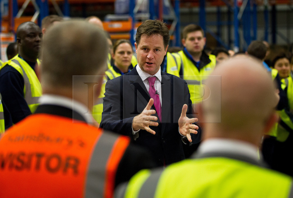 © Licensed to London News Pictures. 25/06/2013. London, UK. British Deputy Prime Minister, Nick Clegg, talks to Sainsbury's employees during the opening of the supermarket chain's new state of the art logistics centre in Charlton, London, today (25/06/2013). The logistics centre, currently responsible for supplying around 90 supermarkets in the South East, has so far created 60 jobs on site, with another 1000 to follow in the next three years. Photo credit: Matt Cetti-Roberts/LNP