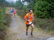 Kerhonkson, New York - Ted Listokin runs through Minnewaska State Park Preserve during the Shawangunk Ridge Trail Run/Hike 20-mile race on Sept. 20, 2014.