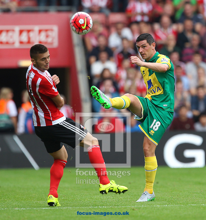 Graham Dorrans of Norwich and Dusan Tadic of Southampton in action during the Barclays Premier League match at the St Mary's Stadium, Southampton<br /> Picture by Paul Chesterton/Focus Images Ltd +44 7904 640267<br /> 30/08/2015