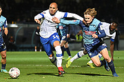 Wycombe Wanderers striker Alex Samuel (25) battles for possession  with Tranmere Rovers defender Jake Caprice (14) during the The FA Cup match between Wycombe Wanderers and Tranmere Rovers at Adams Park, High Wycombe, England on 20 November 2019.
