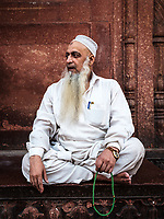 NEW DELHI, INDIA - CIRCA NOVEMBER 2018:  Portrait of muslin man at the Jama Masjid mosque in Old Delhi. Constructed in red sandstone and white marble the mosque is a popular tourist attraction in Delhi.