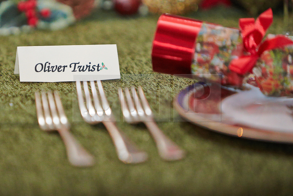 © Licensed to London News Pictures.  09/11/2013. WOODSTOCK, UK. A place setting for Oliver Twist on the grand Saloon table at Blenheim Palace. The table is set for a feast inspired by the classic story A Christmas Carol during as part of a Dickensian Christmas. The themed event opened to the public today (Sat 9th Nov) and runs until the 13th December.  Photo credit: Cliff Hide/LNP