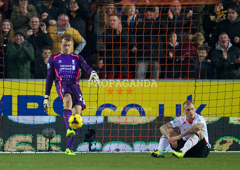 HULL, ENGLAND - Sunday, December 1, 2013: Liverpool's goalkeeper Simon Mignolet and Martin Skrtel look dejected as Hull City score the third goal during the Premiership match at the KC Stadium. (Pic by David Rawcliffe/Propaganda)