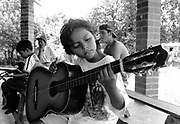 A young girl from the Music for Hope project taking part in a music lesson led by UK based tutor Katherine Rogers.<br /> Community of Amando Lopez,<br /> Bajo Lempa, El Salvador.1999