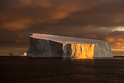 Iceberg in Antarctic Sound at sunrise