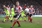 Lincoln City midfielder Elliott Whitehouse (4) watches the ball during the EFL Sky Bet League 2 match between Lincoln City and Exeter City at Sincil Bank, Lincoln, United Kingdom on 30 March 2018. Picture by Mick Atkins.