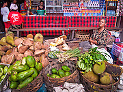 Apr. 25 -- UBUD, BALI, INDONESIA:    A fruit vendor in the Ubud local market with coconut, papaya, jackfruit and limes. The local market is where Balinese buy their produce and meats. It's in the basement of the main tourist market in Ubud. Ubud is considered Bali's artistic and cultural heart. About 20 miles from the beaches near Kuta, it attracts a slightly older crowd.  PHOTO BY JACK KURTZ