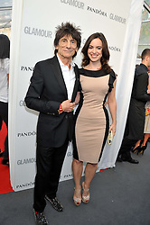 RONNIE WOOD and SALLY HAMPHRIES at the Glamour Women of the Year Awards 2012 in association with Pandora held in Berkeley Square Gardens, London W1 on 29th May 2012.