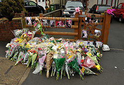 © Licensed to London News Pictures. File pic dated 28/01/2013. Bristol, UK. Flowers  left at the scene where Ross and Clare Simons  were killed when the tandem bike they were riding was hit by a car. Nicholas Lovell, who was driving the car that knocked them off their tandem bike today admitted two counts of causing death by dangerous driving. Photo credit : Simon Chapman/LNP