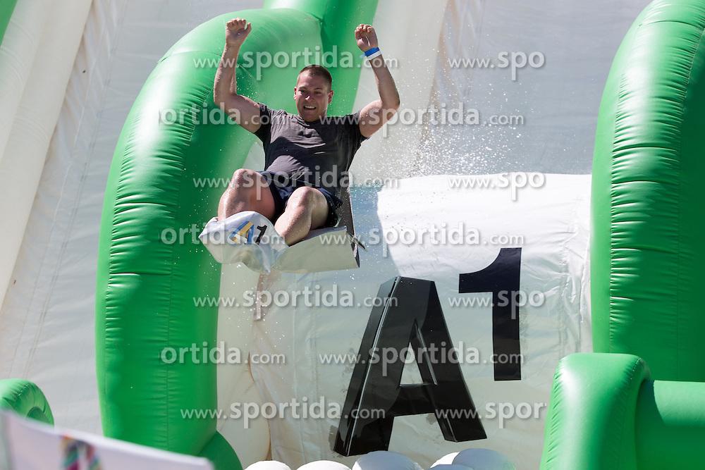 30.07.2013, Klagenfurt, Strandbad, AUT, A1 Beachvolleyball EM 2013, in photo Fan at A1 slide during the A1 Beachvolleyball European Championship at the Strandbad Klagenfurt, Austria on 20130730. (Photo by Matic Klansek Velej / Sportida)