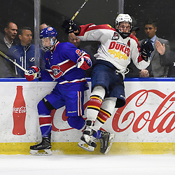BUFFALO, NY - SEP 20,  2017: Ontario Junior Hockey League Governors Showcase game between the Toronto Jr. Canadiens and Wellington Dukes, Jordan Kreller #23 of the Toronto Jr. Canadiens  takes the hit from Eric Uba #4 of the Wellington Dukes during the second period.<br /> (Photo by Andy Corneau / OJHL Images)
