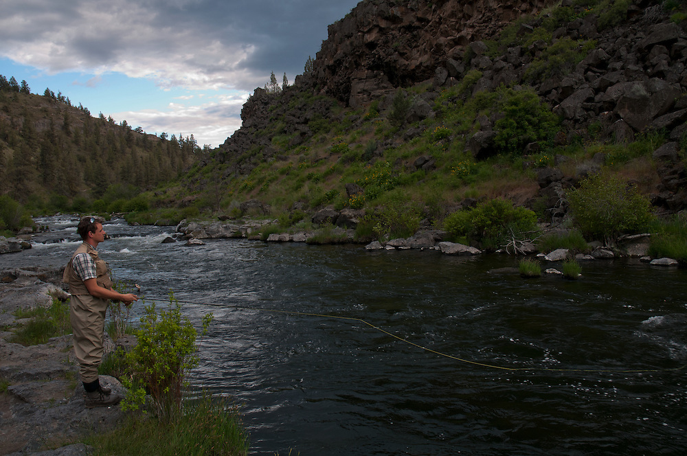 A fisherman casts at a rising trout while fishing the Deschutes River.