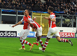 Arsenal's Lukas Podolski celebrates his goal with team mates - Photo mandatory by-line: Dougie Allward/JMP - Mobile: 07966 386802 - 22/10/2014 - SPORT - Football - Anderlecht - Constant Vanden Stockstadion - R.S.C. Anderlecht v Arsenal - UEFA Champions League - Group D