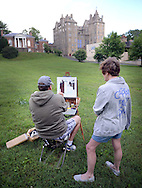 "Addie Hocynec, right, of Lansdale, Pennsylvania and a painter herself, speaks with fellow artist John Schmidtberger, left, as he paints a picture during the first ever Bucks County Plein Air Festival Wednesday June 8, 2016 at the Mercer Museum in Doylestown, Pennsylvania.  The competitively-selected artists will paint outdoors ""en plein air"" or ""in open air"" over the course of three days in various locations throughout the county to create various landscapes and streetscapes. (Photo by William Thomas Cain)"