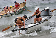 CAPE MAY, NJ - AUGUST 9: Female lifeguards compete in the Women's Surf Boat competition during the United States Lifesaving Association Lifeguard Championships August 9, 2003 in Cape May, New Jersey. Lifeguards from all over the U.S. and Canada compete for the title of National Champion not for prizes, but for the right to say they are the best lifeguards in the country. Lifeguards compete in Surf Swim, Rescue Board Races, Surf Boat Races, Ironman/Ironwomen, and Beach Flag events for three days every August. This year the event was held in Cape May, New Jersey. (Photo by William Thomas Cain/Getty Images)