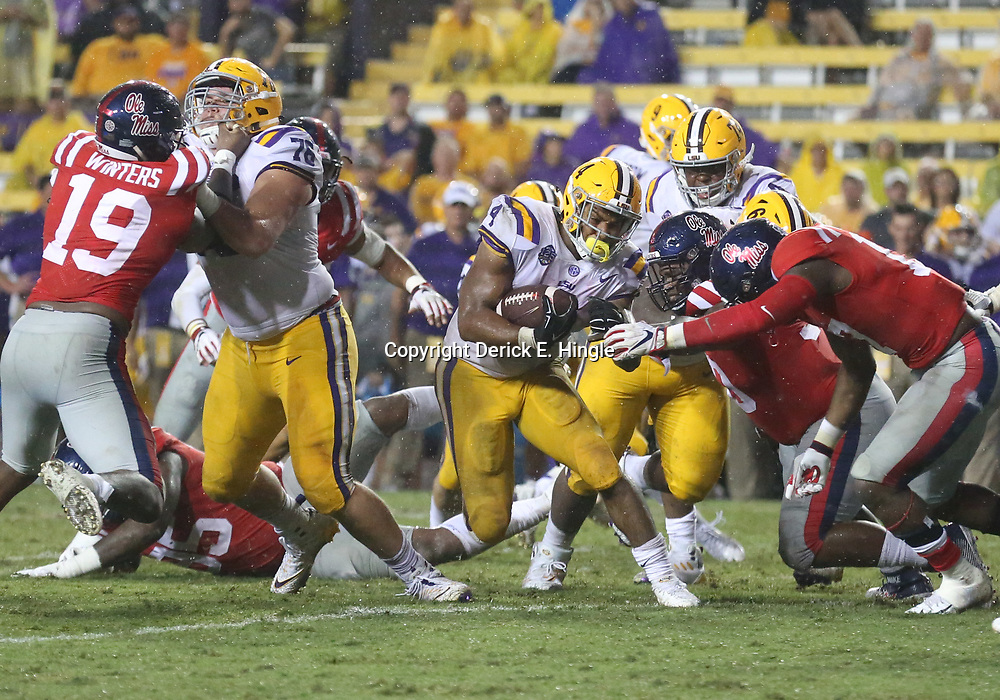 Sep 29, 2018; Baton Rouge, LA, USA; LSU Tigers running back Nick Brossette (4) runs against the Mississippi Rebels during the second half of a game at Tiger Stadium. Mandatory Credit: Derick E. Hingle-USA TODAY Sports