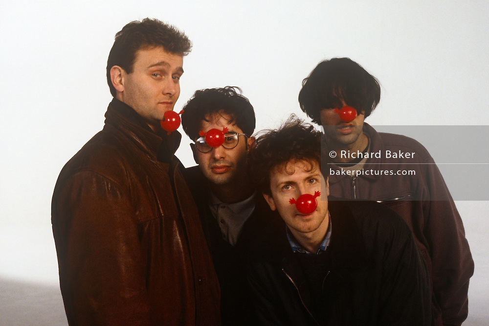 Members of the 'Mary Whitehouse Experience' during the filming of Comic Relief's 1991 video 'Stonk', filmed on 24th January 1991 in London, England. L-R: Hugh Dennis, David Baddiel, Steve Punt and Rob Newman.